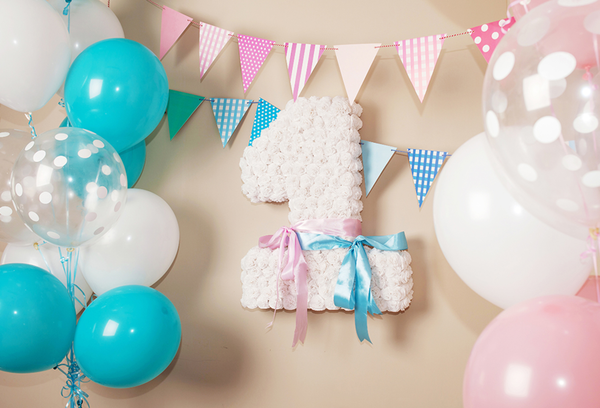 Decorated number 1 for a birthday. Happy birthday one year for twins. White, pink, blue colors